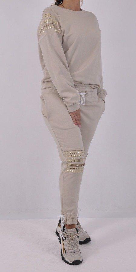 Bluza beżowa z ozdobnymi nitami M/L
