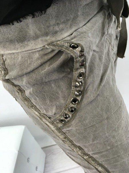Spodnie beżowe z ozdobnym lampasem