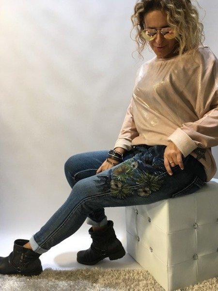 Spodnie jeans w kwiaty L